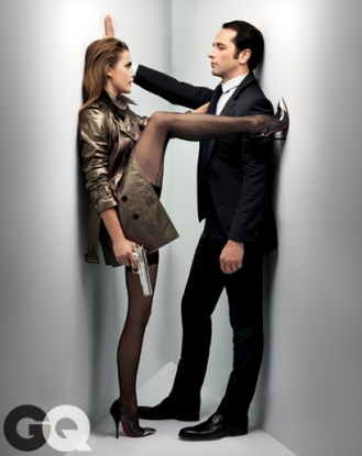 His suit (throughout), Louis Vuitton. Shirt and tie, Burberry London. Shoes, Jil Sander. Her coat, Burberry London. Stockings, Agent Provocateur. Heels, Christian Louboutin.